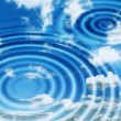 Water ripples with clouds reflected — Stock Photo