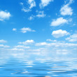 Blue sky with water reflection — Stock Photo