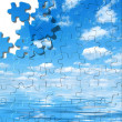 Blue sky with water reflection puzzle — Stock Photo