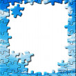 Royalty-Free Stock Photo: Blue sky with water, puzzle border