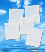 Instant photo frames over summer sky — Stock Photo