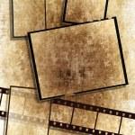 Film strip and film plates, grunge — Stock Photo