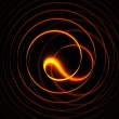 Fiery circular motions on black — Stock Photo