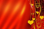 Golden hearts over red — Stock Photo