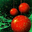Stock Photo: Red Christmas balls on green background