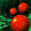 Red Christmas balls on green background - Stock Photo