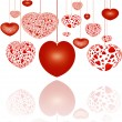 Decorative red hearts on strings — Stock Photo