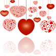 Decorative red hearts on strings — 图库照片