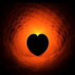 Fiery red heart on black background — Stock Photo