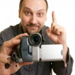 Man shoots video with a camera — Stock Photo #2665566