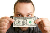 Man holds one dollar bill — Stock Photo