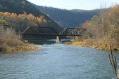 BRIDGE SPANNING WINTER WATER — Stock Photo
