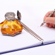 Stock Photo: Writing with pen