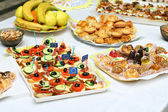 Catering buffet style - different light snack and sandwiches — 图库照片