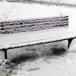 Icy bench in winter park — Stock Photo