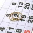 Wedding rings on a calendar — Stock Photo
