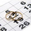 Stock Photo: Two wedding ring on calendar