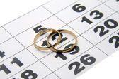 Two wedding ring on a calendar — Stock Photo