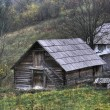 Wooden shack on mountain meadow — Stock Photo