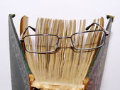 Glasses on open book — Stock Photo