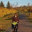Autumn walk with baby — Stock Photo