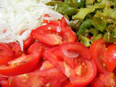 Mix salad - red tomatoes onion and green — Stock Photo