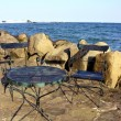 Chair and table on the beach — Stock Photo