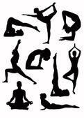 Yoga silhouettes - vector — Stock Vector