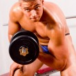 Stock Photo: Novice bodybuilder training