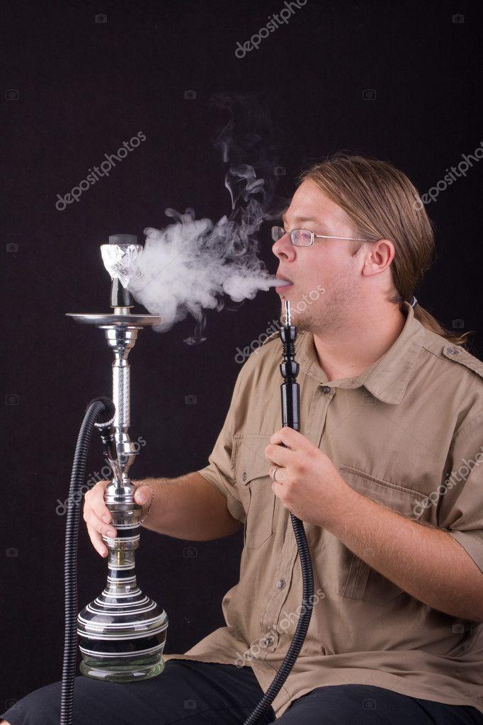 Young Man Smoking Hookah Stock Photo Istvan Csak 1841690 Designjpg