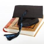 Graduate cap with book — Stock Photo