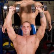 Stock Photo: Bodybuilders training in gym