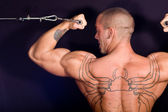 Bodybuilder training in the gym — Stock Photo