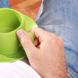 Royalty-Free Stock Photo: Man holding green cup