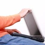 Young man closing his laptop — Stock Photo