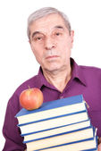 Senior professor with books and apple — Stock Photo
