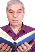 Senior professor reading a book — Stock Photo