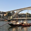 Boats and D. Luis bridge - Stock Photo