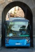 Bus across the wall — Stock Photo