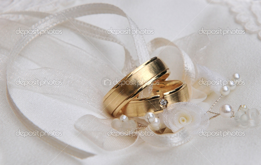 Golden wedding rings with decoration before ceremony.  Stock Photo #2143145