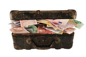 Suitcase full of money — Stock Photo