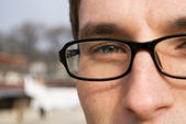 Close-up portrait of young man in glasse — Stock Photo
