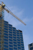 Construction - new blue glass building a — Stock Photo