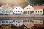 Reflection colourful house in the river — Stock Photo