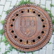 Stock Photo: Closed manhole with emblem in Prague