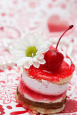 Sweet fruit red cake with cherry and white camomile — Stock Photo