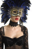Beautiful woman with a carnival masque — Stock Photo