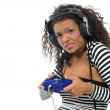 Beautiful curly brunette girl playing game conso — Stock Photo #1795946