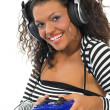 Beautiful curly brunette girl playing game conso — Stock Photo