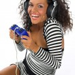 Beautiful curly brunette girl playing game conso — Stock Photo #1796001